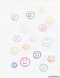 a page covered in happy face drawn with crayon