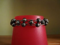 a photo of a bracelet made of wire and beads